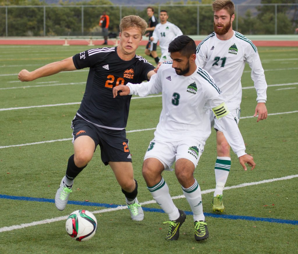 Cascades defender Sukh Dhaliwal clears the ball out of harm's way.