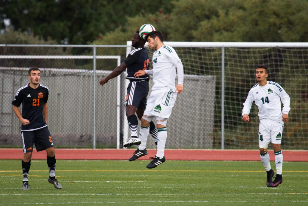 UFV's Michael Mobilio goes up for a header against TRU on Sunday. (Andrew Snucins / TRU Athletics)