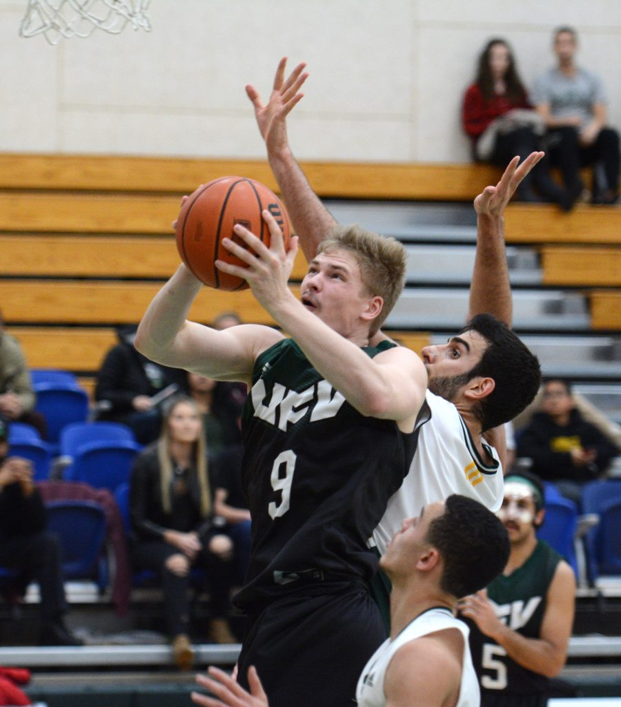 UFV's Andrew Morris drives for a layup.
