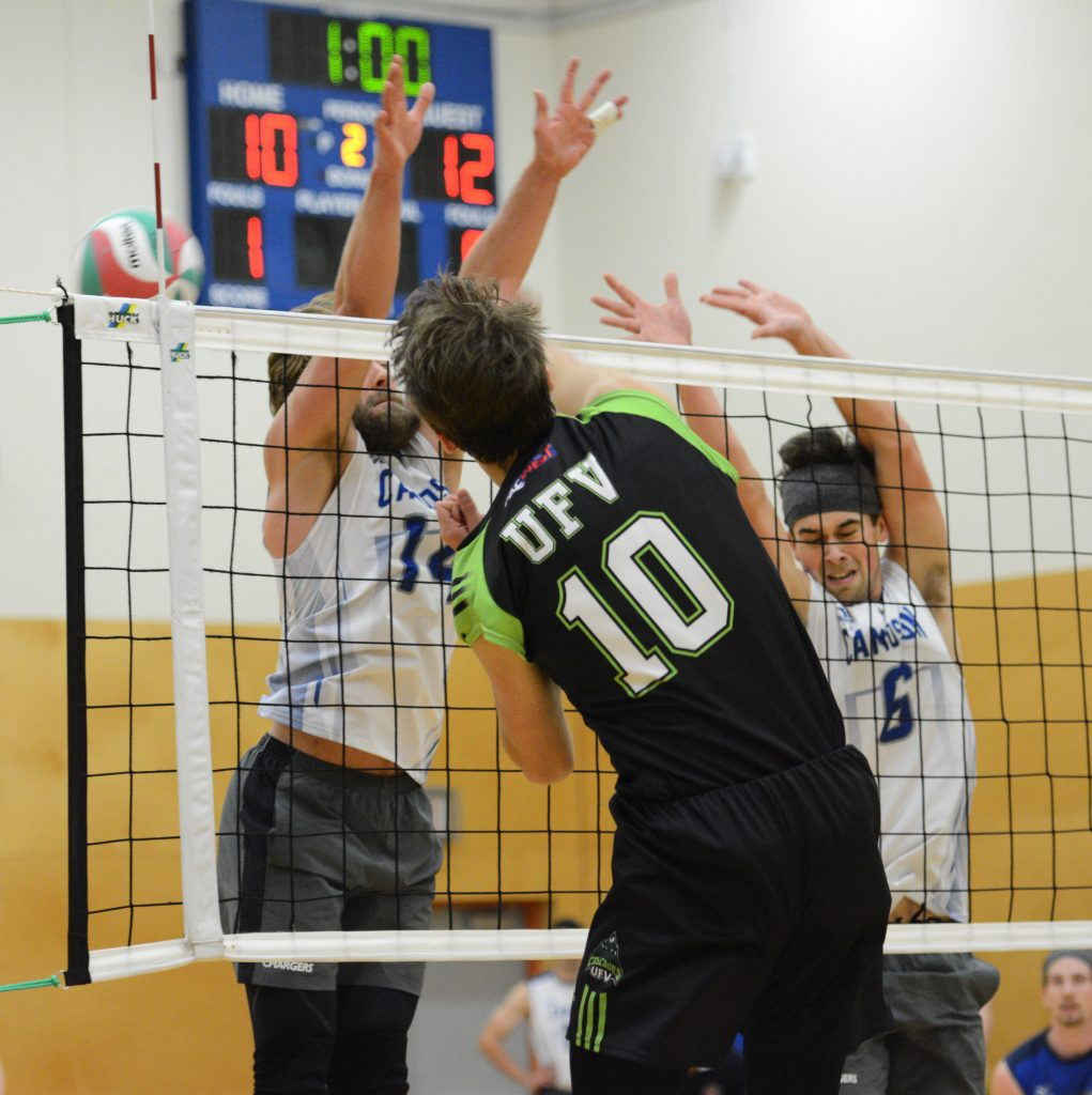 Ben Friesen hammers one of his 17 kills through the Chargers' block.
