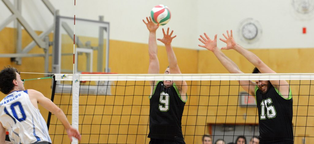 UFV's Adam Frederickson and Dayton Pagliericci go up for a block against Camosun on Saturday.