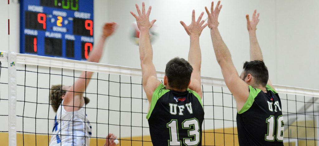 Joel Kleingeltink (13) and Dayton Pagliericci of the Cascades go up for a block last weekend vs. Camosun.