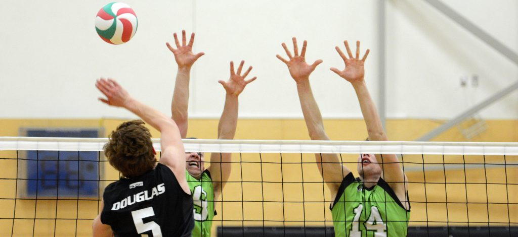 UFV's Adam Frederickson and Connor Pruim go up for a block against the Douglas Royals on Friday evening.