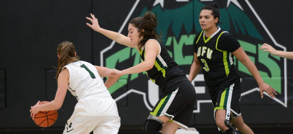 UFV's Jessica Zawada and Shayna Litman give some defensive attention to Sask's Libby Epoch.