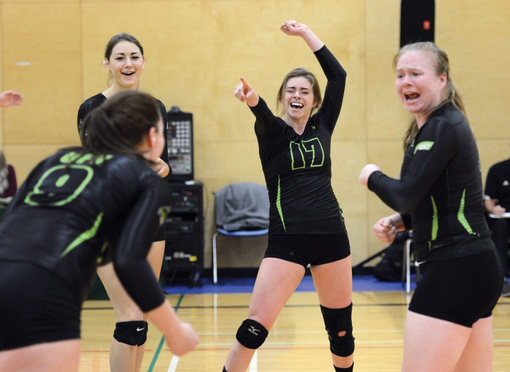 The Cascades' Mandelyn Erikson, Monique Huber, Jessica Funk and Rachel Funk (from left) celebrate a point during Saturday's win over Camosun.